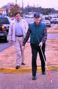 Orientation and Mobility instructor with older man walking with cane