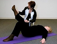 woman exercising with instructor