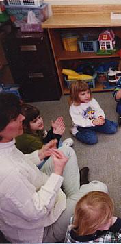 teacher and students in a preschool class