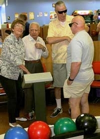 Picture of group of older culturally diverse individuals in bowling alley