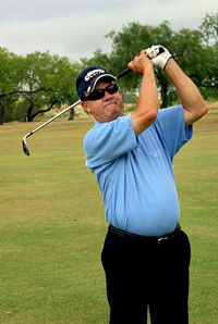 Picture of older golfer with vision loss swing a golf club