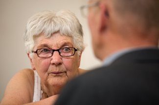 older woman talking to counselor