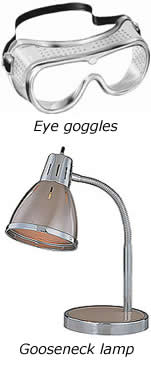 this is an image of eye goggles and a gooseneck lamp