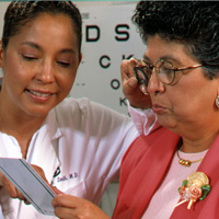 Woman being checked by an optometrist