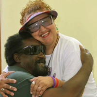 two people with low vision hugging