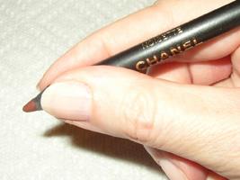 hold an eyebrow pencil near the point