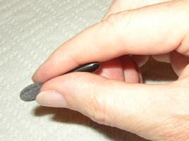 hold eyeshadow applicator near the tip