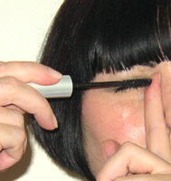 rest the point of the mascara wand against your index finger