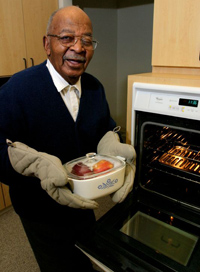 man showing off the casserole he cooked