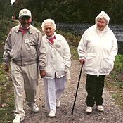 three seniors walking together as part of a walking club
