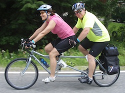 Scott Anderson Biking with a friend