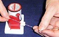 Pull both strands into the thread cutter, severing the thread from the spool.