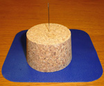 Stick your needle into a cork or piece of soap