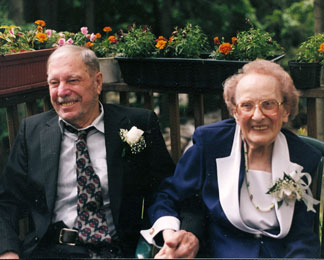 Paul and Dorothy Johnson, sitting on a deck, smiling