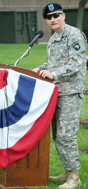 Sgt. Mittman standing at a podium