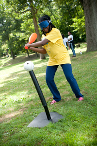 a girl at the 2012 family conference takes     aim during teeball practice