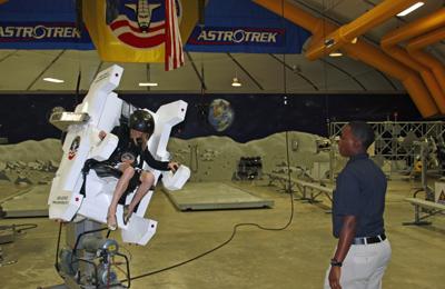 a camper operating the MMU at Space Camp
