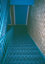 Downward interior blue staircase