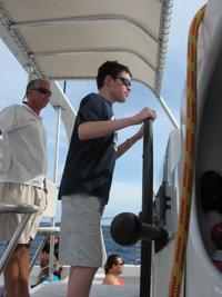 Michael's son Bob piloting a $2 million dollar catamaran!