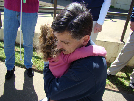 The author and his daughter, hugging