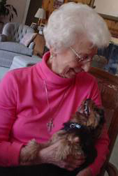 Dr. Elizabeth Cleino, with her dog on her lap