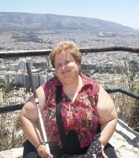 Lora Felty sitting on top of Livivictos Hill