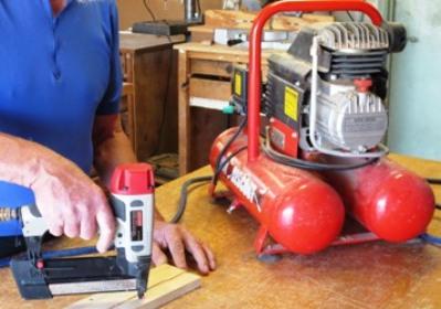 a nail gun with a compressor
