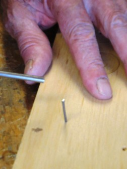 nail is inserted into the wood