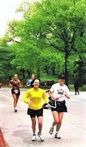 visually impaired runner racing in a marathon with a guide