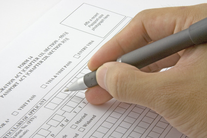 closeup of person filling out an application form