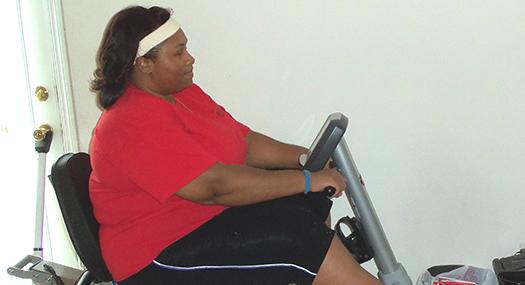 Empish on her recumbent exercise bicycle