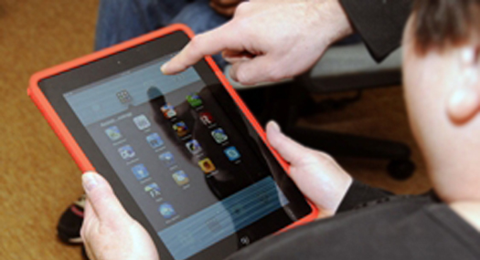 ipad with hand indicating apps on screen