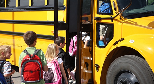 children getting on a yellow schoolbus