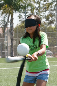 visually impaired girl playing t-ball
