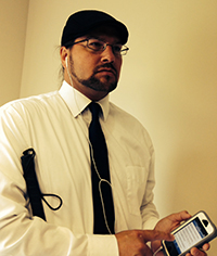 Joe Strechay, using his iPhone