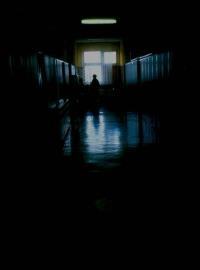 A dark, indistinct hallway