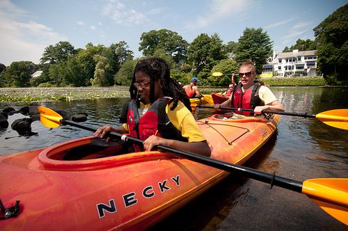 Summer camp girl in kayak