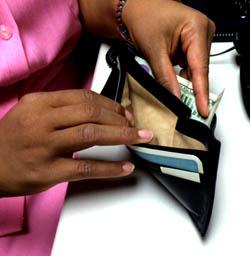 putting money in wallet