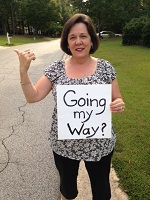 Audrey holding sign saying 'going my way.'