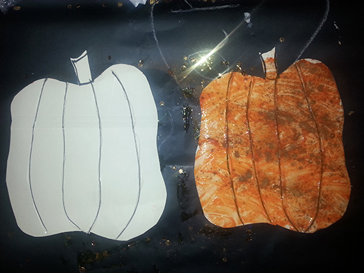 a before-and-after picture of a pumpkin cutout, decorated with finger paint and spices
