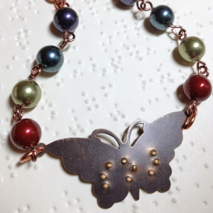 necklace with beads and butterfly with braille