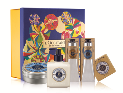 the Shea Embrace gift set from L'Occitane, showing a tin of ultra rich body cream, hand and body wash, foot cream, hand cream, and an extra-gentle soap packed in an illustrated box