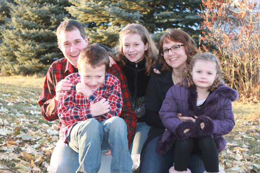 Emily Coleman and her husband and children
