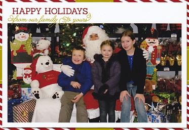 Eddie and sisters sitting with Santa