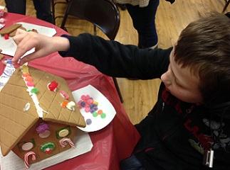 Eddie decorating gingerbread house