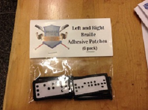 right and left adhesive patches in braille