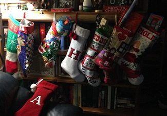 multiple stockings belonging to Eddie and cousins