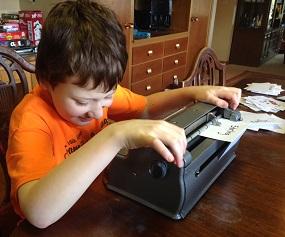 Eddie using a Perkins brailler