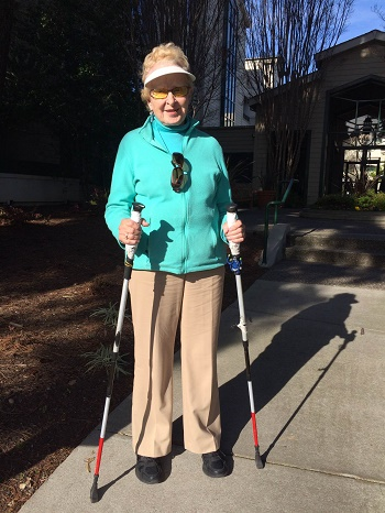 ski poles modified with red and white tape to be used as mobility canes