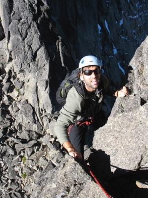 Erik W. rock climbing